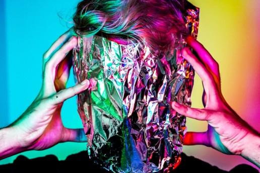 Tin Foil Surrounding Face with Colourful Background